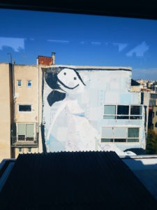 This piece takes up the whole side of a building in Monastiraki