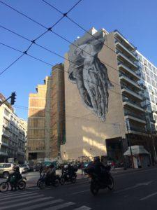 "Art done by P. Tsakonas located on Piraeus street, based on Albrecht Durer's drawing ""Praying Hands"""