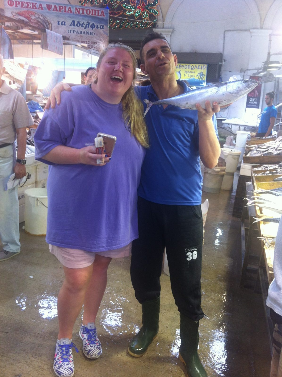 Caroline Bass, amused by the over friendly fish vendors asking to have their photos taken with her!