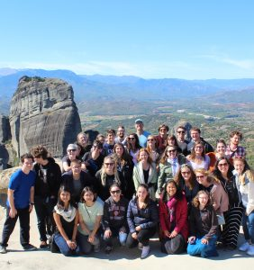 Group photo near the edge of a natural rock pillar in Meteora!