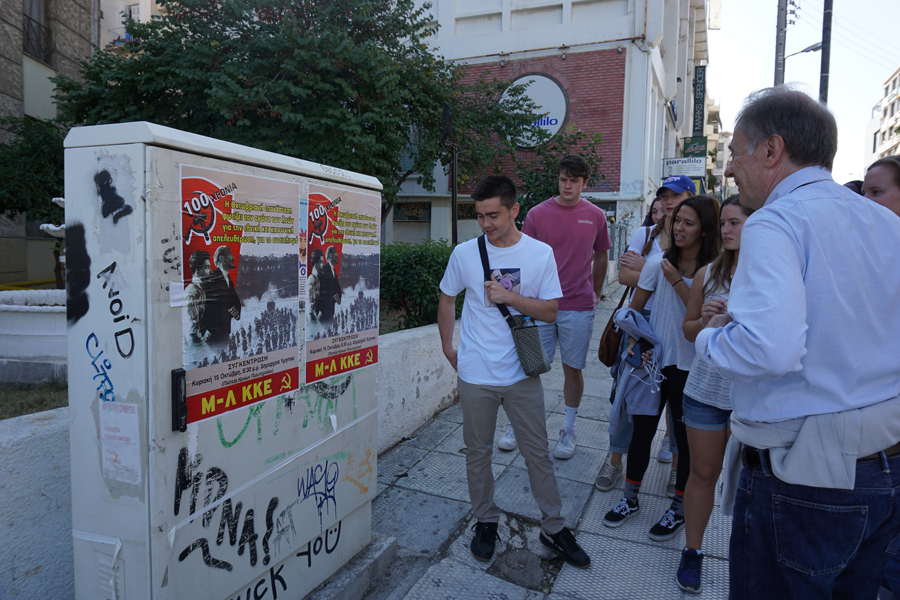 observing and discussing political posters on Athenian streets