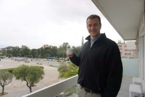 Billy holding a cup of coffee on the CYA balcony