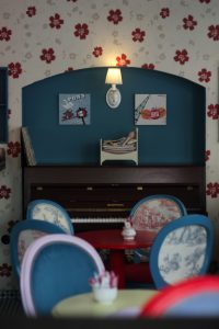 The retro red-and-blue interior of cafe Petite Fleur